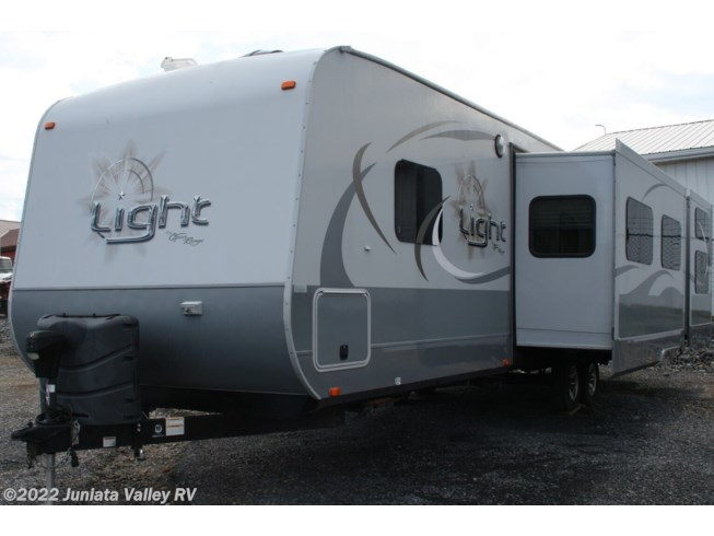 2015 Highland Ridge Open Range Light 308 BHS - Used Travel Trailer For Sale by Juniata Valley RV in Mifflintown, Pennsylvania features 50 Amp Service, Air Conditioning, Alloy Wheels, AM/FM/CD, Black Tank Flush, Booth Dinette, Bunk Beds, Bunkhouse, Cable Prepped, CO Detector, Converter, Detachable Power Cord, Electric Jack, Enclosed Underbelly, Exterior Refrigerator, Exterior Speakers, External Shower, Fantastic Fan, Fiberglass Sidewalls, Fire Extinguisher, Furnace, Glass Shower Door, Island Kitchen, Ladder, Leather Furniture, Leveling Jacks, Load Lights, LP Detector, Microwave, Non-Smoking Unit, Outside Entertainment Center, Outside Kitchen, Oven, Overhead Cabinetry, Pantry, Pass Thru Storage, Power Awning, Propane, Queen Bed, Queen Mattress, Refrigerator, Roof Vent, Screen Door, Second Roof A/C, Self Contained, Sewer Hose & Carrier, Shower, Skylight, Slam Latch Baggage Doors, Slideout, Smoke Detector, Spare Tire Kit, Stereo System, Stove, Stove Cover, Tinted Windows, Toilet, TV, TV Antenna, Water Heater