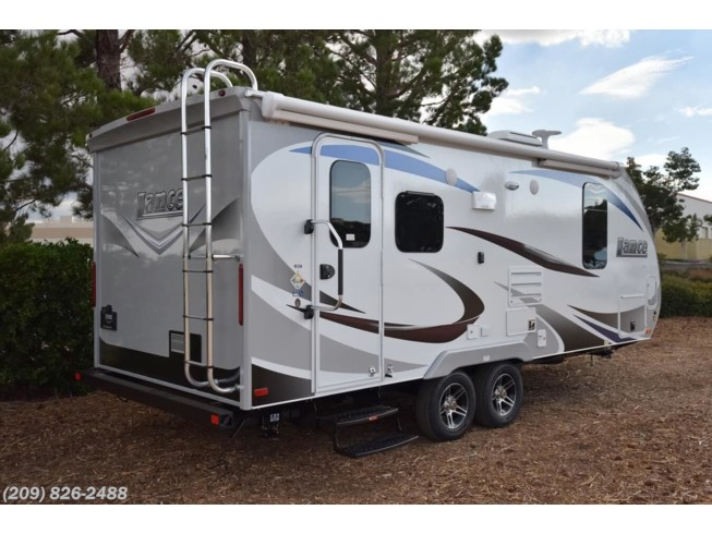 2019 Lance TT 1995 - New Travel Trailer For Sale by Toscano RV in Los Banos, California features 30 Amp Service, Air Conditioning, Alloy Wheels, Aluminum Entrance Steps, AM/FM/CD, Auxiliary Battery, Black Tank Flush, Booth Dinette, Cable Prepped, CD Player, CO Detector, Detachable Power Cord, Dinette Bed, DVD Player, Electric Heat, Enclosed Underbelly, Enclosed Water Tank, Escape Door, Exterior Speakers, External Shower, Fantastic Fan, Fiberglass Sidewalls, Fire Extinguisher, Furnace, Heated Water Tank, Keyless Entry, Ladder, Leather Furniture, LED Lights, Leveling Jacks, LP Detector, Medicine Cabinet, Microwave, Mini Blinds, Multi Media Sound System w/Input Jacks, Oven, Overhead Cabinetry, Pillow Top Mattress, Power Awning, Power Hitch Jack, Power Roof Vent, Queen Bed, Queen Mattress, Refrigerator, Removable Table, Roof Vents, Satellite Prepped, Satellite Radio, Screen Door, Shower, Skylight, Slam Latch Baggage Doors, Slideout, Slide-out Awning, Smoke Detector, Solar Prep, Spare Tire Kit, Stabilizer Jacks, Stereo System, Stove, Stove Top Burner, Tinted Windows, Toilet, TV, TV Antenna, U-Shaped Dinette, Wardrobe(s), Water Heater