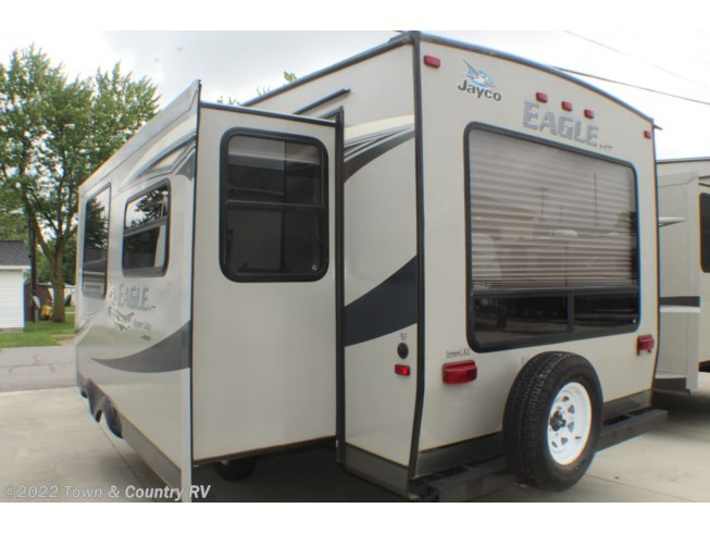2012 Jayco Eagle Super Lite HT 26.5 RLS - Used Fifth Wheel For Sale by Town & Country RV in Clyde, Ohio features Air Conditioning, Auxiliary Battery, Awning, Booth Dinette, CD Player, CO Detector, DVD Player, Exterior Speakers, External Shower, Leveling Jacks, LP Detector, Medicine Cabinet, Microwave, Outside Entertainment Center, Outside Kitchen, Oven, Queen Bed, Refrigerator, Rocker Recliner(s), Roof Vents, Shower, Skylight, Slideout, Smoke Detector, Stove Top Burner, Surround Sound System, Toilet, TV, Water Heater