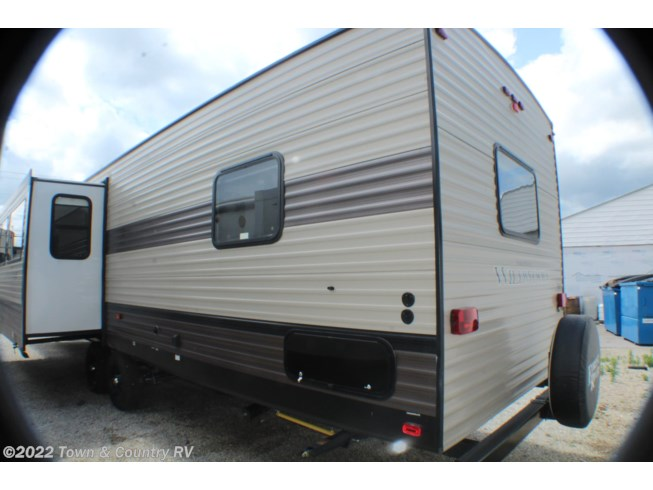 2020 Forest River Wildwood 37BHSS2Q - Used Travel Trailer For Sale by Town & Country RV in Clyde, Ohio features Air Conditioning, Auxiliary Battery, Awning, Booth Dinette, CO Detector, Exterior Speakers, Fireplace, Leveling Jacks, LP Detector, Medicine Cabinet, Microwave, Oven, Power Roof Vent, Queen Bed, Refrigerator, Roof Vents, Shower, Slideout, Smoke Detector, Stove Top Burner, Surround Sound System, Toilet, Water Heater