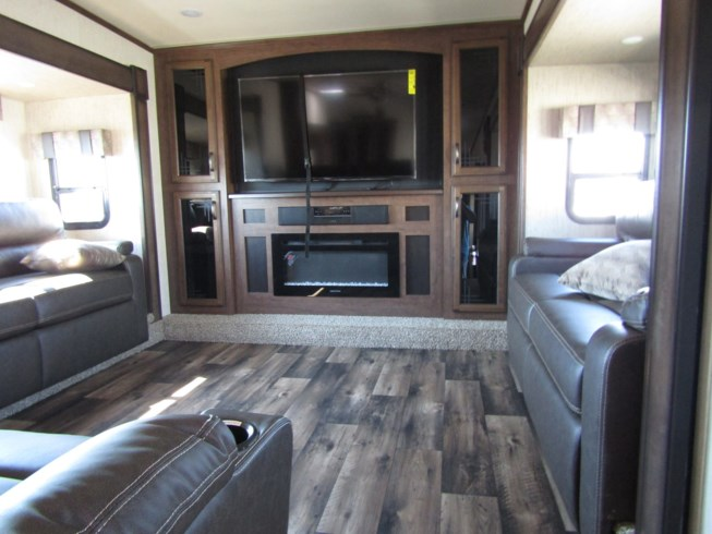 2019 Forest River Sandpiper 379FLOK - New Fifth Wheel For Sale by First Choice RVs in Rock Springs, Wyoming features 50 Amp Service, Air Conditioning, Alloy Wheels, AM/FM/CD, Automatic Leveling Jacks, Auxiliary Battery, Awning, Battery Charger, Black Tank Flush, Bluetooth Stereo, Cable Prepped, CD Player, Ceiling Fan, CO Detector, Detachable Power Cord, DVD Player, Enclosed Underbelly, Exterior Grill, Exterior Speakers, External Shower, Fantastic Fan, Fiberglass Sidewalls, Fire Extinguisher, Fireplace, Free Standing Dinette w/Chairs, Glass Shower Door, Heated Underbelly, Heated Water Tank, Hide-A-Bed, Inverter, Island Kitchen, King Size Bed, Kitchen Sink, Ladder, Leather Furniture, LED HDTV, LED Lights, Leveling Jacks, Load Lights, LP Detector, Medicine Cabinet, Microwave, Non-Smoking Unit, Outside Kitchen, Oven, Pantry, Pass Thru Storage, Power Awning, Power Roof Vent, Propane, Recliner(s), Refrigerator, Rocker Recliner(s), Roof Vent, Roof Vents, Satellite Prepped, Screen Door, Second Roof A/C, Self Contained, Sewer Hose & Carrier, Shower, Skylight, Slideout, Smoke Detector, Sofa Bed, Solar Prep, Solid Surface Countertops, Spare Tire Kit, Stainless Appliances, Stereo System, Stove, Stove Top Burner, Surround Sound System, Table and Chairs, Thermal Pane Windows, Tinted Windows, Toilet, TV, TV Antenna, Upgraded Insulation Package, Vanity, Wardrobe(s), Washer/Dryer Prep, Water Heater