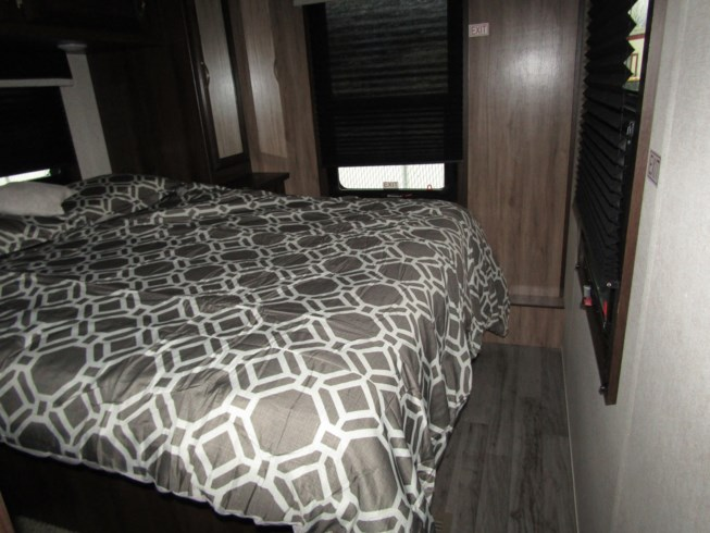 2019 Jayco White Hawk 25FK - New Travel Trailer For Sale by First Choice RVs in Rock Springs, Wyoming features 50 Amp Service, Air Conditioning, Alloy Wheels, AM/FM/CD, Auxiliary Battery, Battery Charger, Black Tank Flush, Bluetooth Stereo, Cable Prepped, CD Player, CO Detector, Detachable Power Cord, Diamond Shield Paint Protection Film, DVD Player, Electric Jack, Enclosed Underbelly, Enclosed Water Tank, Exterior Speakers, External Shower, Fantastic Fan, Fiberglass Sidewalls, Fire Extinguisher, Furnace, Glass Shower Door, Inverter, Kitchen Sink, Ladder, Leather Furniture, LED Lights, Leveling Jacks, Load Lights, LP Detector, Medicine Cabinet, Microwave, Non-Smoking Unit, Outside Kitchen, Oven, Overhead Cabinetry, Pass Thru Storage, Power Awning, Power Hitch Jack, Power Roof Vent, Power Stabilizer Jacks, Propane, Queen Bed, Queen Mattress, Recliner(s), Refrigerator, Removable Table, Roof Vent, Roof Vents, Satellite Prepped, Screen Door, Self Contained, Sewer Hose & Carrier, Shower, Skylight, Slideout, Smoke Detector, Solar Prep, Solid Surface Countertops, Spare Tire Kit, Stereo System, Stove Top Burner, Surround Sound System, Tinted Windows, Toilet, TV, TV Antenna, Vanity, Water Heater