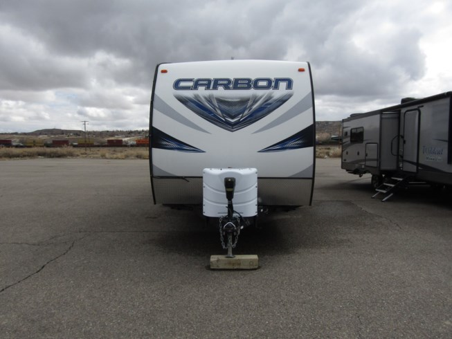2016 Keystone Carbon 31 - Used Toy Hauler For Sale by First Choice RVs in Rock Springs, Wyoming features Skylight, Shower, Refrigerator, Awning, Roof Vents