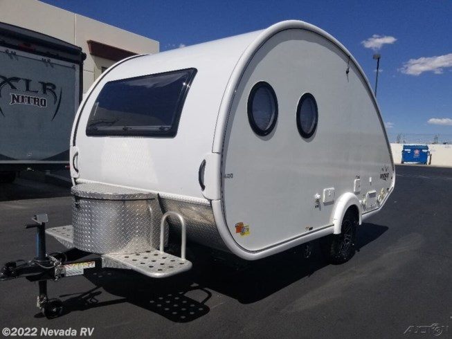 2020 NuCamp TAB 400 - Used Travel Trailer For Sale by Nevada RV in Las Vegas, Nevada features Air Conditioning, Auxiliary Battery, Booth Dinette, CD Player, CO Detector, DVD Player, External Shower, Leveling Jacks, LP Detector, Power Roof Vent, Queen Bed, Refrigerator, Roof Vents, Shower, Smoke Detector, Spare Tire Kit, Stove Top Burner, Toilet, TV, Water Heater
