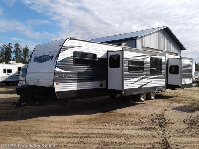 2016 Keystone Springdale 38FL - Used Travel Trailer For Sale by Friendship RV Inc. in Friendship, Wisconsin features 50 Amp Service, Air Conditioning, Auxiliary Battery, Booth Dinette, Exterior Speakers, External Shower, Fireplace, Leveling Jacks, Medicine Cabinet, Microwave, Oven, Power Awning, Queen Bed, Refrigerator, Roof Vents, Shower, Skylight, Slideout, Stove Top Burner, Toilet, TV, TV Antenna, Water Heater
