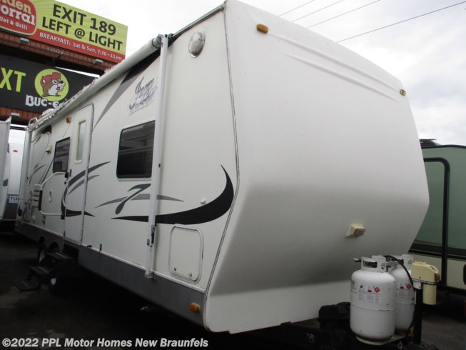 2005 Thor Jazz 2610FQ - Used Travel Trailer For Sale by PPL Motor Homes New Braunfels in New Braunfels, Texas features Air Conditioning, Microwave, Non-Smoking Unit, Refrigerator, Slideout, Spare Tire Kit, Stabilizer Jacks, Stove, TV, Water Heater