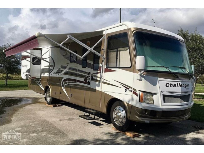 2011 Damon Challenger 348 - Used Class A For Sale by POP RVs in West Palm Beach, Florida features Air Conditioning, Awning, Generator, Leveling Jacks, Slideout