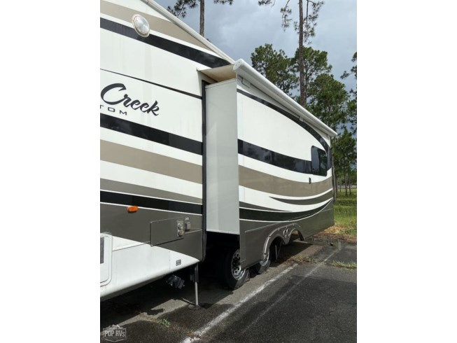 2013 Forest River Cedar Creek 36CKTS - Used Fifth Wheel For Sale by POP RVs in Pensacola, Florida features Air Conditioning, Awning, Leveling Jacks, Slideout