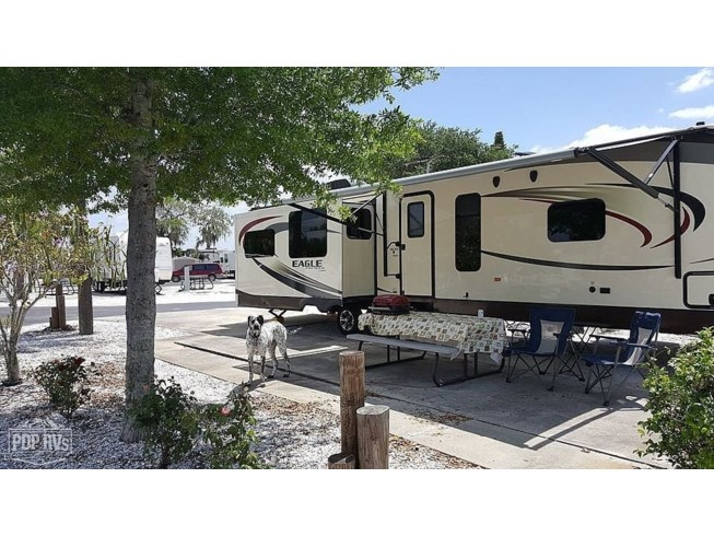 2015 Jayco Eagle 338 RETS - Used Travel Trailer For Sale by POP RVs in Jacksonville, Florida features Slideout, Air Conditioning, Awning