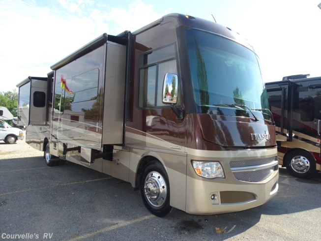 2015 Itasca Suncruiser 37F - Used Class A For Sale by Courvelle's RV in Opelousas, Louisiana features 50 Amp Service, Air Conditioning, AM/FM/CD, Automatic Leveling Jacks, Auxiliary Battery, Backup Camera, Backup Monitor, Bath & 1/2, Ceiling Fan, CO Detector, Convection Microwave, Dryer, External Shower, Fantastic Fan, Fiberglass Sidewalls, Fire Extinguisher, Full Body Paint, Furnace, Generator, Glass Shower Door, Hitch, King Size Bed, Kitchen Sink, Ladder, Leather Furniture, LP Detector, Medicine Cabinet, Non-Smoking Unit, Pass Thru Storage, Pocket Door(s), Power Awning, Power Entrance Step, Power Roof Vent, Power Seats, Propane, Raised Refrigerator Panels, Refrigerator, Roof Vents, Satellite Dish, Screen Door, Second Roof A/C, Self Contained, Shower, Side View Cameras, Skylight, Slam Latch Baggage Doors, Slideout, Smoke Detector, Solid Surface Countertops, Stove Cover, Stove Top Burner, Surround Sound System, Tinted Windows, Toilet, TV, TV Antenna, Wardrobe(s), Washer, Water Heater