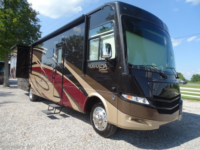 2017 Coachmen Mirada Select 37TB - Used Class A For Sale by Courvelle's RV in Opelousas, Louisiana features 50 Amp Service, 6-Way Power Driver's Seat, Air Conditioning, Auxiliary Battery, Backup Monitor, Booth Dinette, CD Player, CO Detector, Day/Night Shades, DVD Player, External Shower, Fiberglass Sidewalls, Fireplace, Full Body Paint, Generator, Glass Shower Door, King Size Bed, Kitchen Sink, Ladder, Leather Furniture, Leveling Jacks, LP Detector, Medicine Cabinet, Microwave, Non-Smoking Unit, Outside Entertainment Center, Oven, Pantry, Pass Thru Storage, Power Awning, Power Entrance Step, Power Roof Vent, Propane, Refrigerator, Residential Refrigerator, Roof Vents, Screen Door, Second Roof A/C, Self Contained, Shower, Side View Cameras, Skylight, Slideout, Slide-out Awning, Smoke Detector, Stainless Appliances, Stove Cover, Stove Top Burner, Surround Sound System, Toilet, TV, TV Antenna, Two Full Baths, Wardrobe(s), Water Heater