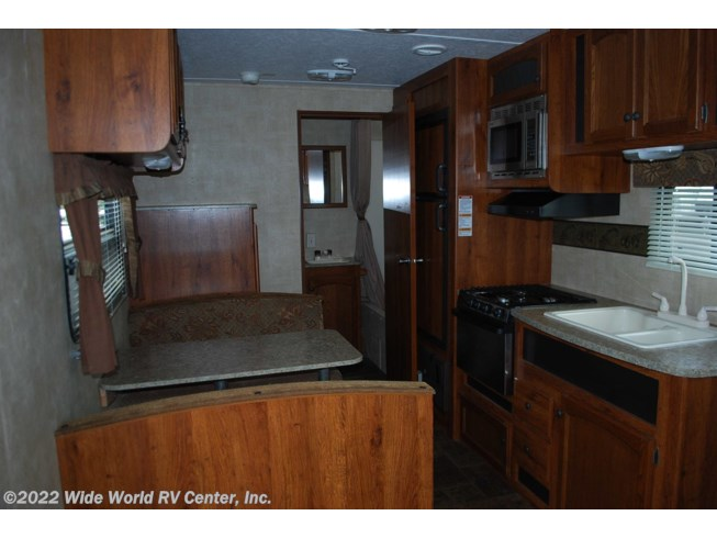2012 Keystone Hornet Hideout 23RB - Used Travel Trailer For Sale by Wide World RV Center, Inc. in Wilkes-Barre, Pennsylvania features Awning, Furnace, Microwave, Refrigerator, Stove Top Burner, Water Heater