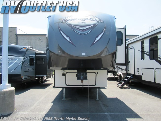 2017 Forest River Wildwood Heritage Glen 372RD - Used Fifth Wheel For Sale by RV Outlet USA of NMB (North Myrtle Beach) in Longs, South Carolina features Air Conditioning, AM/FM/CD, CO Detector, DVD Player, Exterior Speakers, Fireplace, Free Standing Dinette w/Chairs, King Size Bed, Leveling Jacks, LP Detector, Medicine Cabinet, Microwave, Oven, Power Awning, Power Roof Vent, Refrigerator, Rocker Recliner(s), Roof Vents, Shower, Skylight, Slideout, Smoke Detector, Stove Top Burner, Water Heater