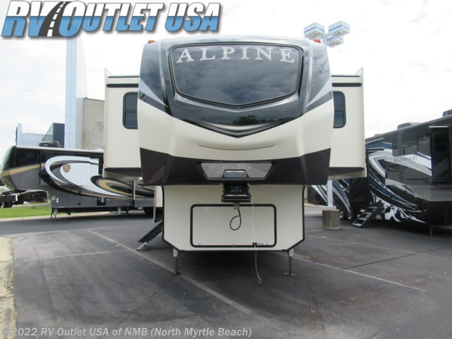 2021 Keystone Alpine 3700FL - New Fifth Wheel For Sale by RV Outlet USA of NMB (North Myrtle Beach) in Longs, South Carolina features Air Conditioning, AM/FM/CD, Automatic Leveling Jacks, Auxiliary Battery, Bluetooth Stereo, Cable Prepped, Ceiling Fan, Central Vacuum, CO Detector, Convection Microwave, Day/Night Shades, DVD Player, Enclosed Underbelly, Exterior Speakers, External Shower, Fire Extinguisher, Fireplace, Free Standing Dinette w/Chairs, Glass Shower Door, Hitch, Island Kitchen, King Size Bed, Kitchen Sink, Ladder, LED HDTV, LED Lights, Leveling Jacks, LP Detector, Medicine Cabinet, Oven, Overhead Cabinetry, Pantry, Power Awning, Power Roof Vent, Propane, Residential Refrigerator, Roof Vents, Satellite Prepped, Screen Door, Second Roof A/C, Shower, Skylight, Slam Latch Baggage Doors, Slideout, Smoke Detector, Sofa Bed, Spare Tire Kit, Stainless Appliances, Stove Top Burner, Surround Sound System, Theater Seating, TV Antenna, Wardrobe(s), Water Heater