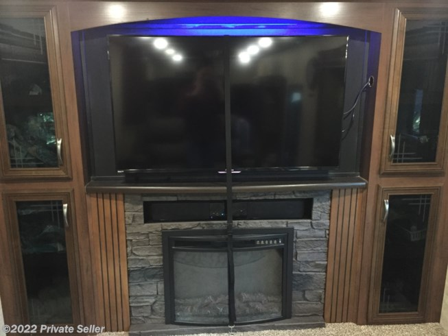 Entertainment, Large 60 in smart tv, with sound bar and DVD, fireplace and storage.