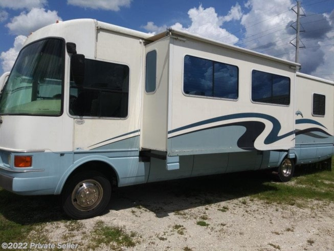 2001 National RV Dolphin - Used Class A For Sale by Private Seller in Osteen, Florida features Air Conditioning, Awning, LP Detector, Microwave, Refrigerator, Slideout, Smoke Detector, Water Heater