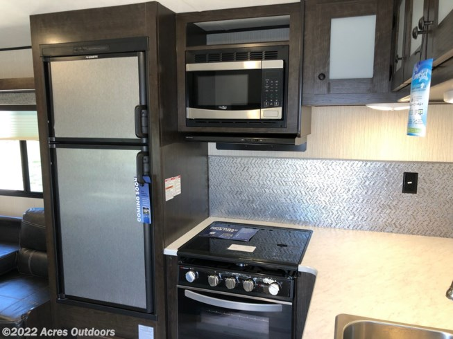 Nice looking stainless steel fridge, microwave and classy looking stove\oven