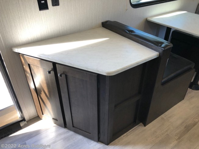 An extra countertop always come in handy, as well as the storage underneath
