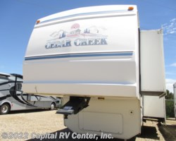 #12057G - 2002 Forest River Cedar Creek 29RKB