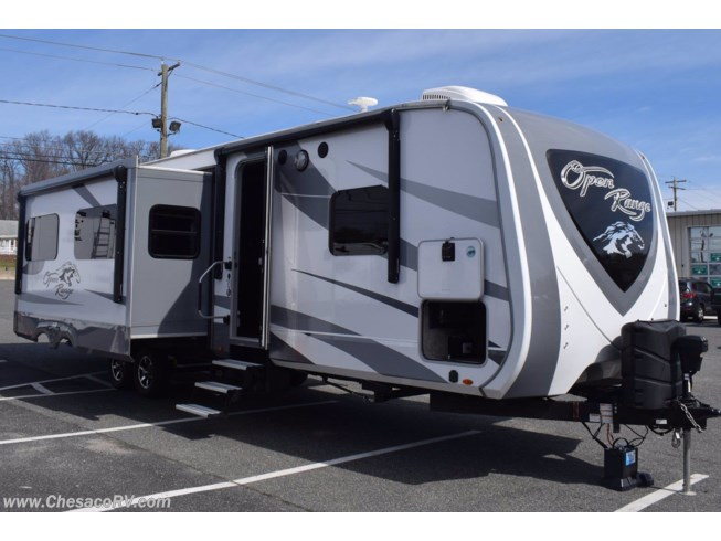 2019 Highland Ridge Open Range 328BHS - Used Travel Trailer For Sale by Chesaco RV in Joppa, Maryland features Air Conditioning, Auxiliary Battery, Awning, Bunk Beds, CD Player, CO Detector, DVD Player, Exterior Speakers, External Shower, Ladder, Leveling Jacks, LP Detector, Medicine Cabinet, Microwave, Outside Kitchen, Oven, Power Roof Vent, Queen Bed, Refrigerator, Roof Vents, Shower, Skylight, Slideout, Smoke Detector, Spare Tire Kit, Stove Top Burner, Toilet, TV, Water Heater