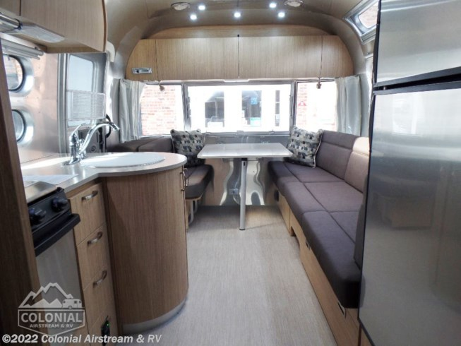 2018 Airstream Flying Cloud 25FBT Twin - Used Travel Trailer For Sale by Colonial Airstream & RV in Millstone Township, New Jersey features Air Conditioning, Auxiliary Battery, Awning, Booth Dinette, CD Player, CO Detector, DVD Player, External Shower, Leveling Jacks, LP Detector, Medicine Cabinet, Oven, Power Roof Vent, Queen Bed, Refrigerator, Roof Vents, Shower, Smoke Detector, Spare Tire Kit, Stove Top Burner, Surround Sound System, Toilet, TV, Water Heater