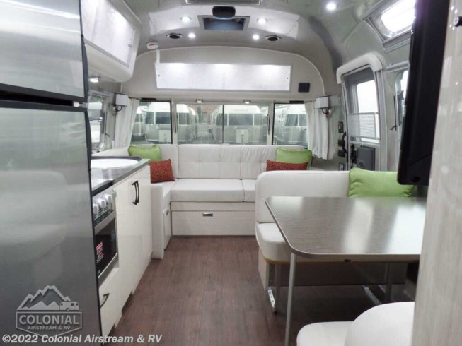 2020 Airstream International Serenity 28RBQ Queen - New Travel Trailer For Sale by Colonial Airstream & RV in Millstone Township, New Jersey features Air Conditioning, Auxiliary Battery, Awning, Backup Monitor, Booth Dinette, CD Player, CO Detector, DVD Player, Exterior Speakers, External Shower, Leveling Jacks, LP Detector, Medicine Cabinet, Oven, Power Roof Vent, Queen Bed, Refrigerator, Roof Vents, Shower, Skylight, Smoke Detector, Spare Tire Kit, Stove Top Burner, Surround Sound System, Toilet, TV, Water Heater