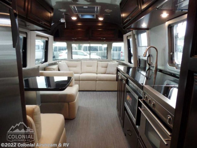 2020 Airstream Classic 30RBQ Queen - New Travel Trailer For Sale by Colonial Airstream & RV in Millstone Township, New Jersey features Air Conditioning, Auxiliary Battery, Awning, Backup Monitor, Booth Dinette, CO Detector, DVD Player, External Shower, Leveling Jacks, LP Detector, Medicine Cabinet, Microwave, Oven, Power Roof Vent, Queen Bed, Refrigerator, Roof Vents, Satellite Radio, Shower, Skylight, Smoke Detector, Spare Tire Kit, Stove Top Burner, Surround Sound System, Toilet, TV, Water Heater